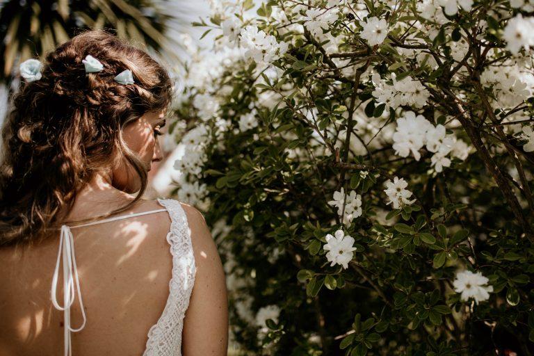Paper rose hair flowers in brides hair