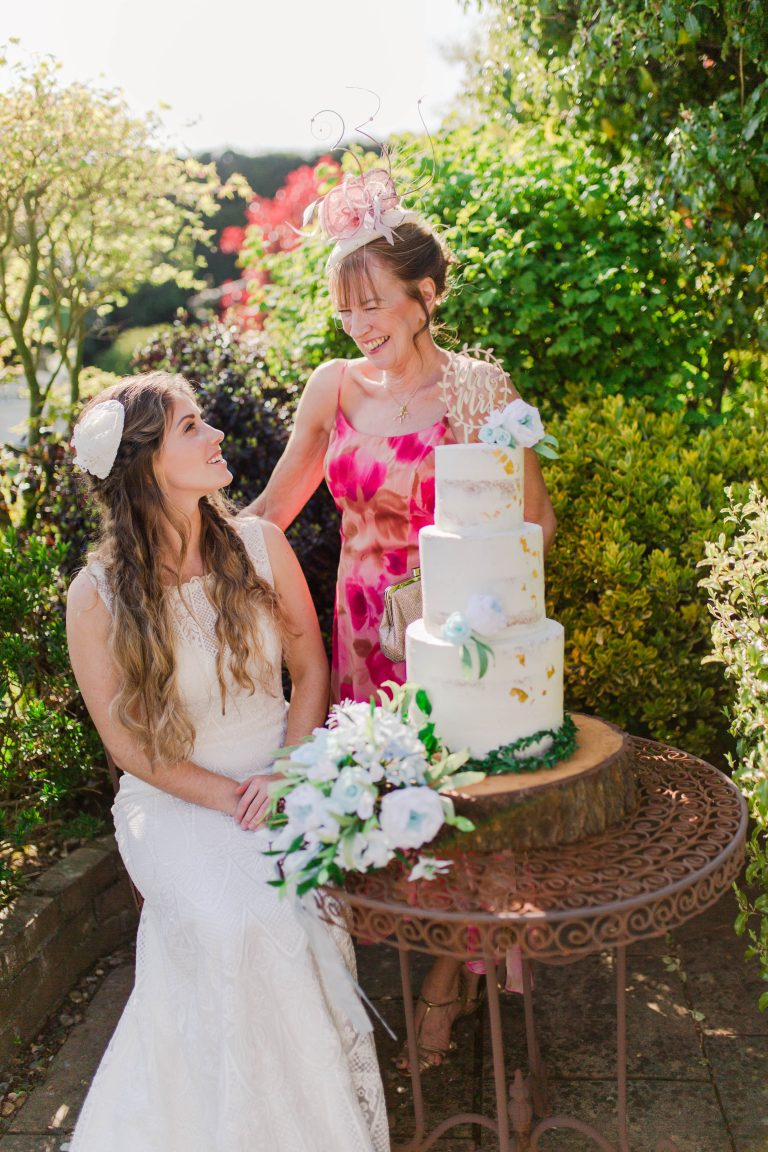 Bride and mother of the bride with wedding cake with paper flowers by Petal and Bird