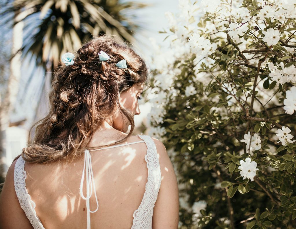 boho themed bride with paper roses in her hair