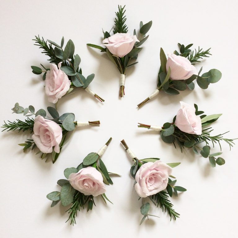 paper rose buttonholes with real foliage
