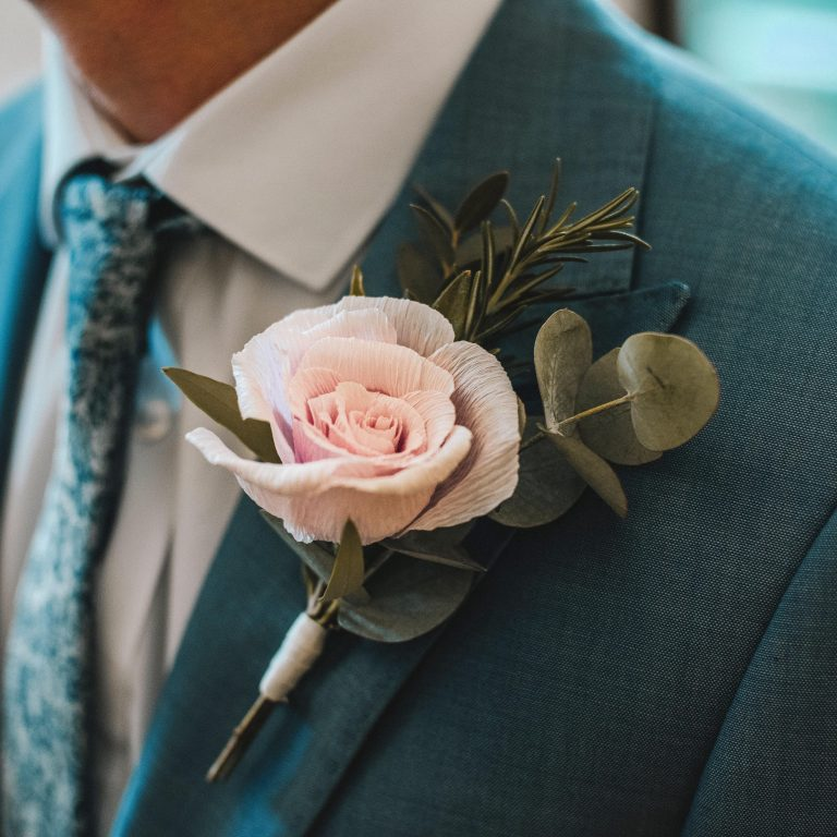 paper rose and real foliage buttonhole