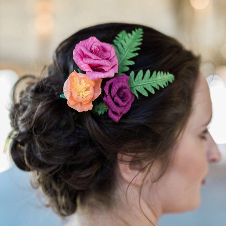 Paper flowers in a bride's hair