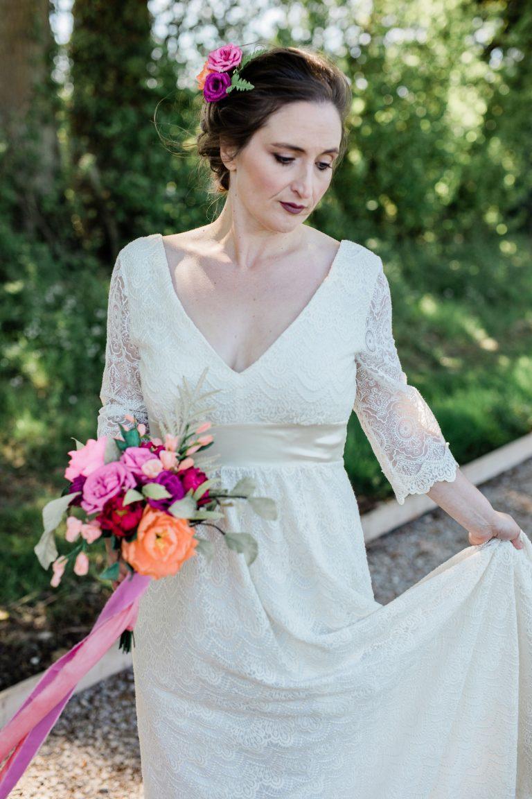 bride holding paper wedding bouquet