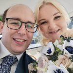 bride and groom wih paper bouquet