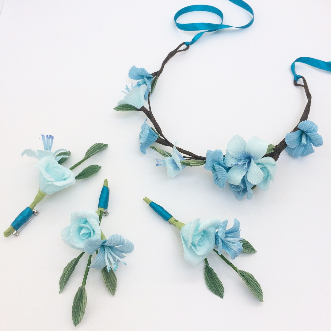 blue paper flower crown and buttonholes