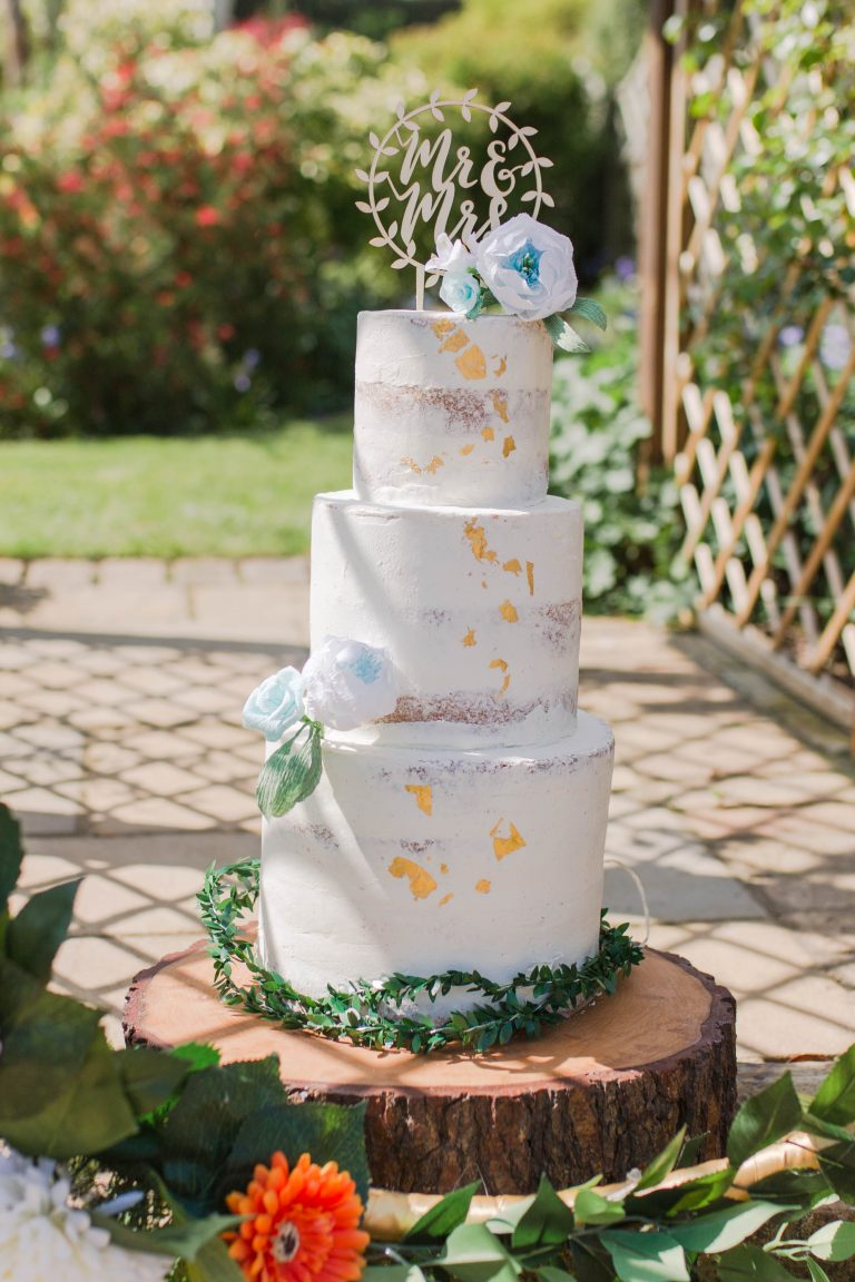 Paper flowers by Petal and Bird decorating a wedding cake