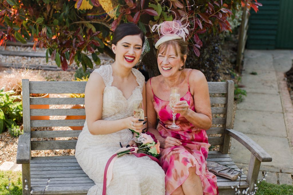 bride and mother of the bride with paper wedding bouquet