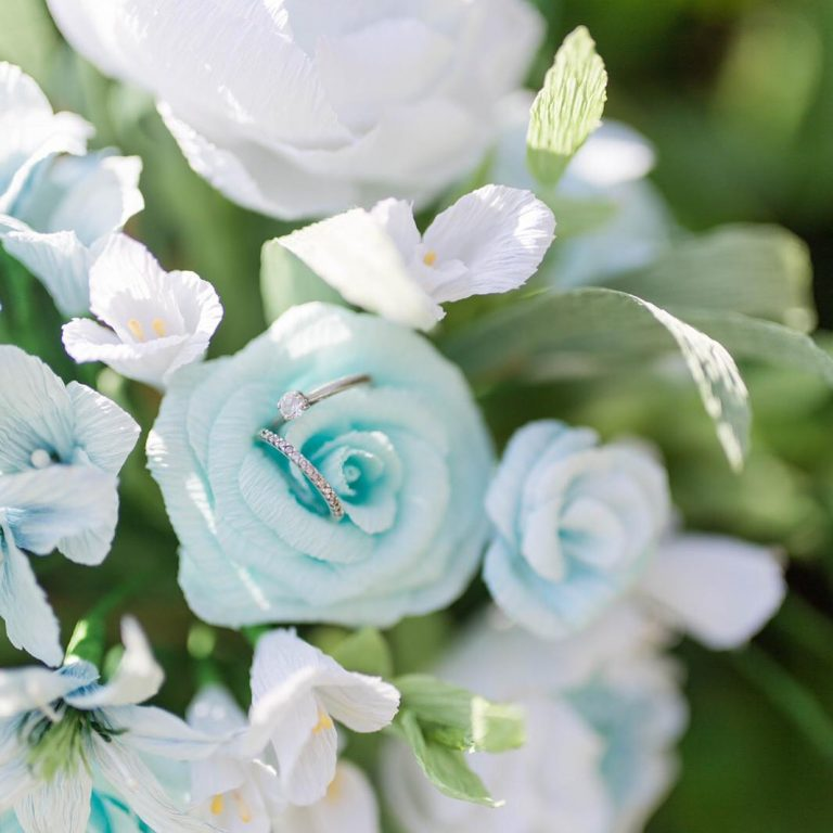 blue and white paper wedding flowers by petal and bird