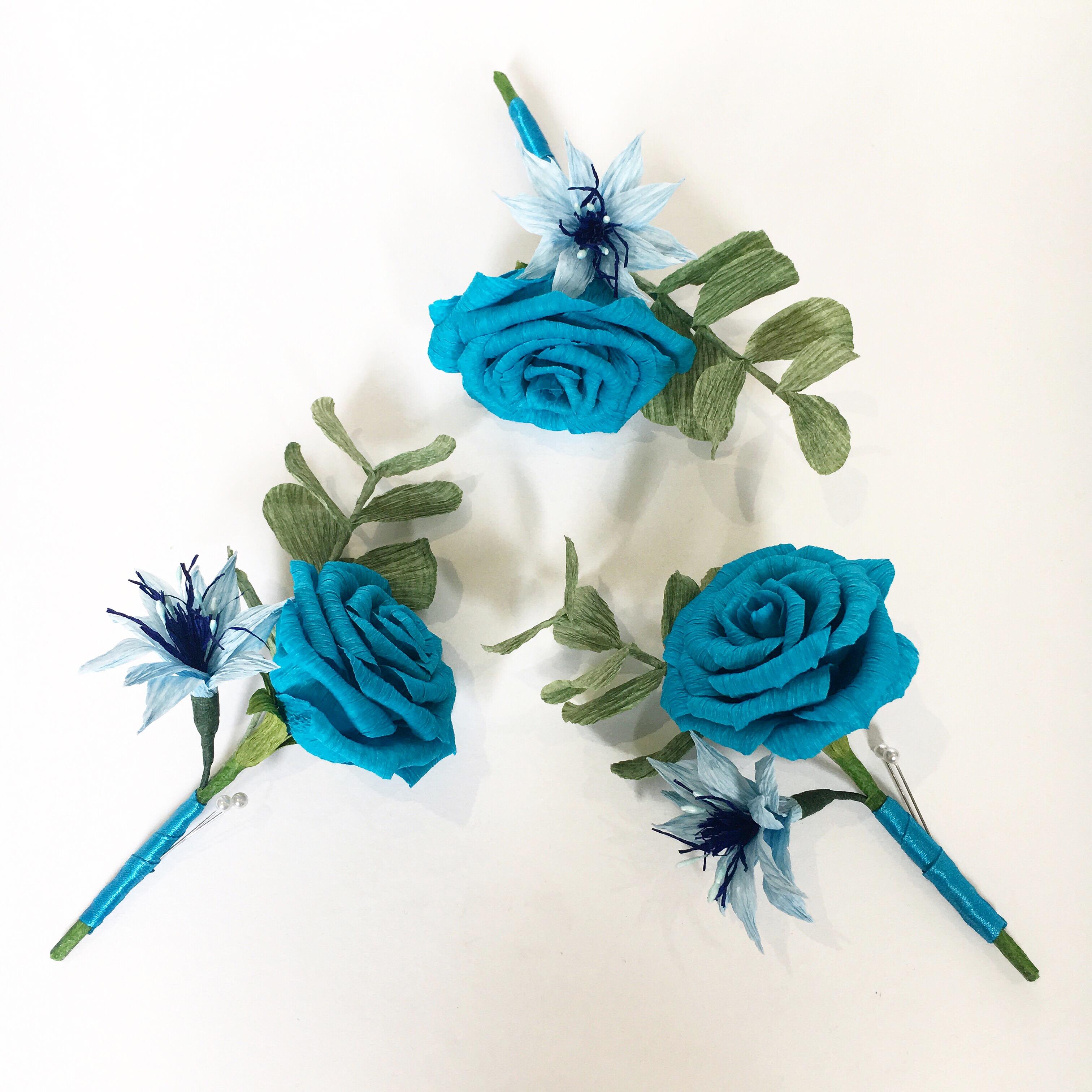 blue aper rose buttonholes