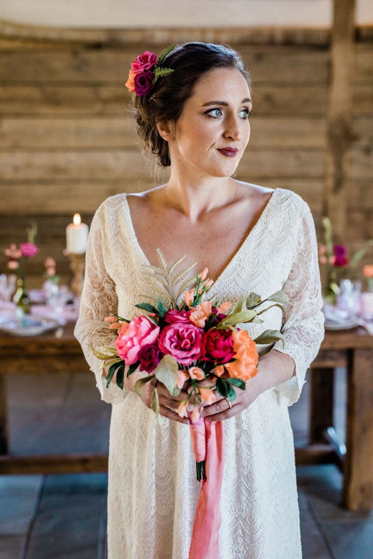 bride with paper wedding bouquet