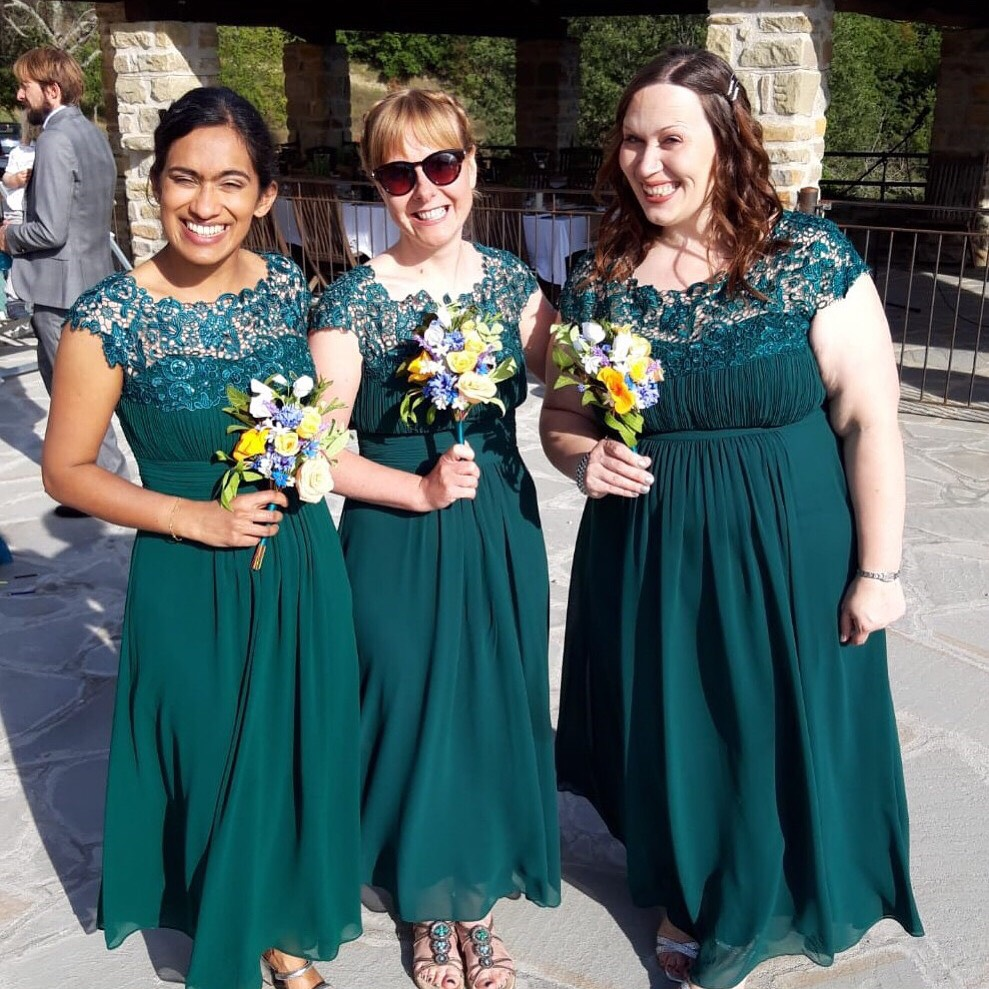 Desitination wedding bridesmaids with paper bouquet