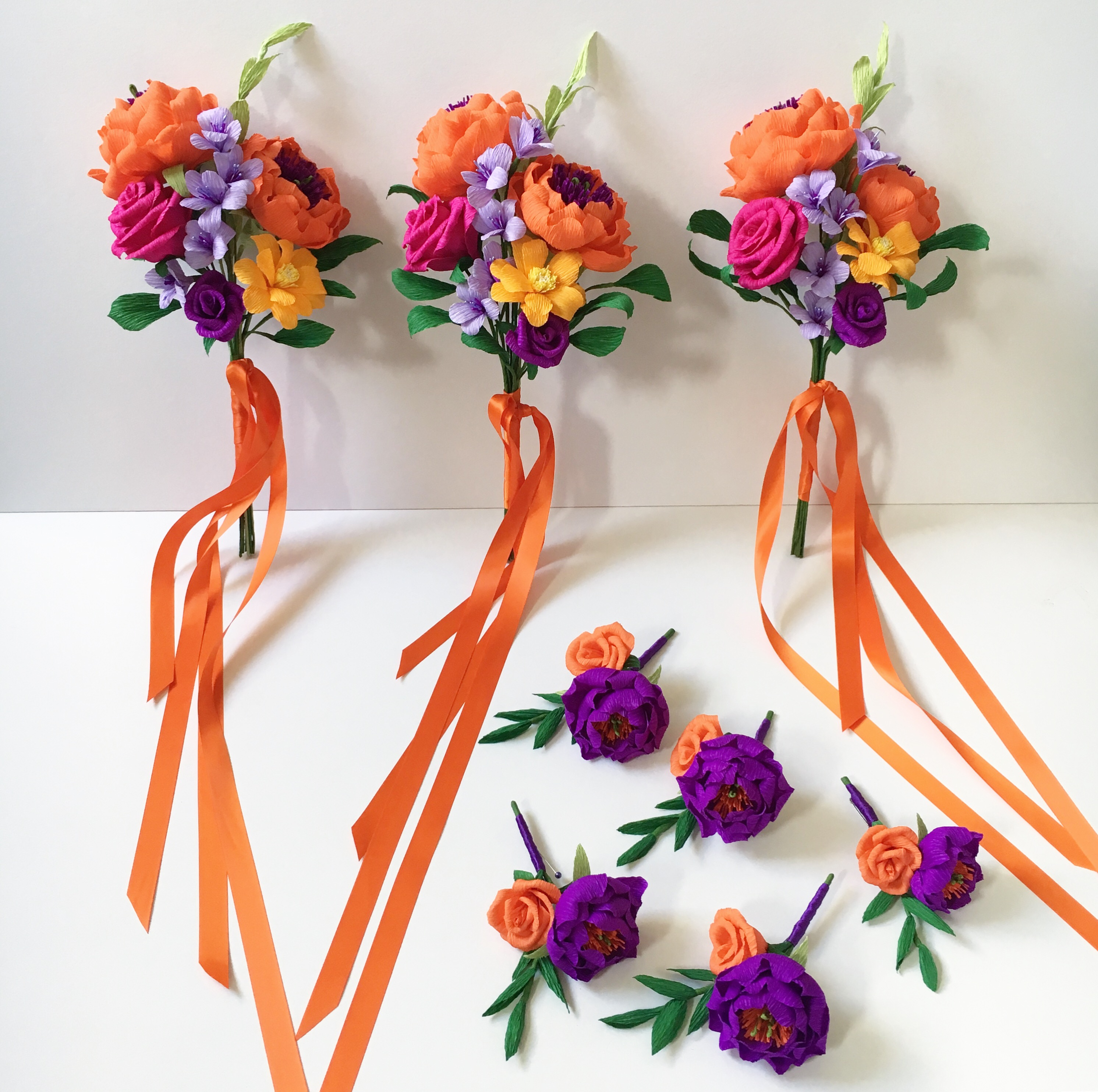 Paper Bridesmaid bouquets and Buttonholes by Petal and Bird