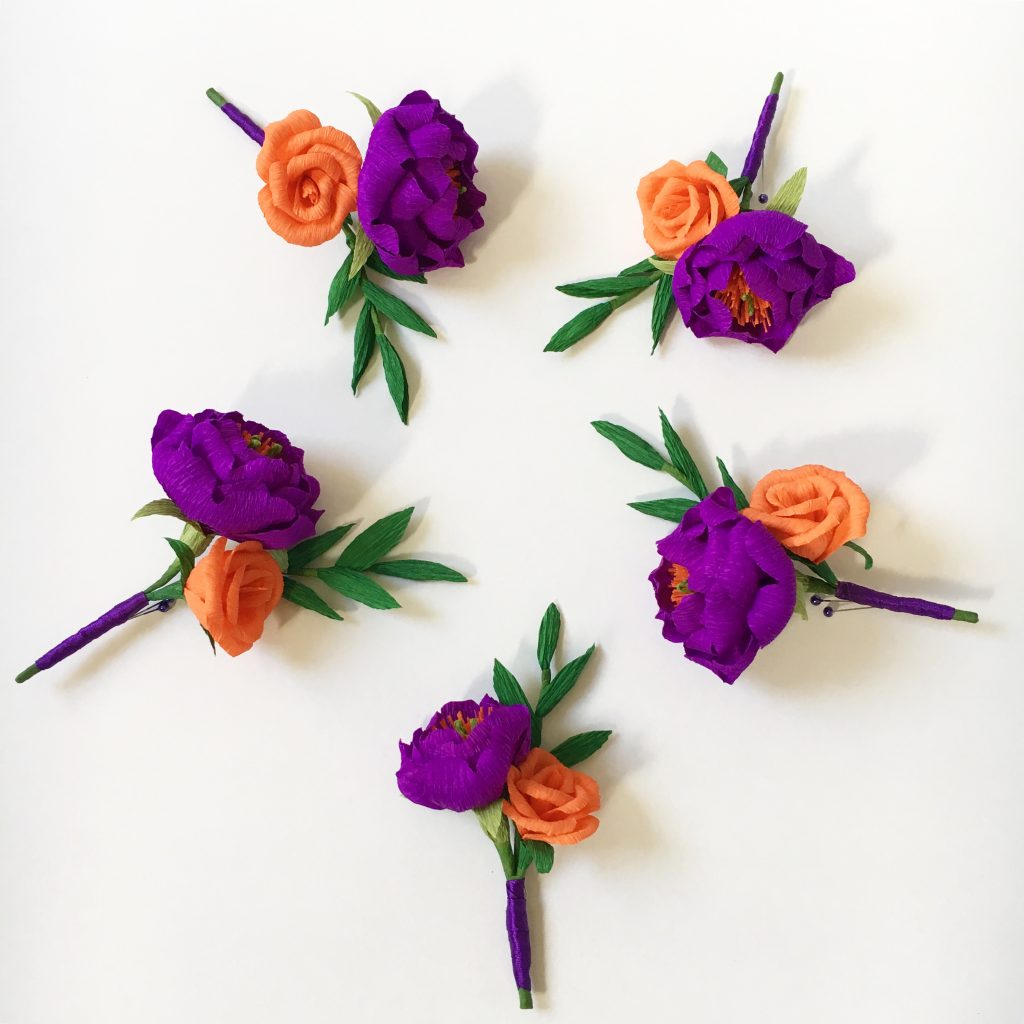 Paper buttonholes featuring peonies and roses