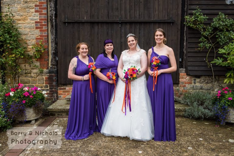bride and bridesmaids with paper flower bouquets
