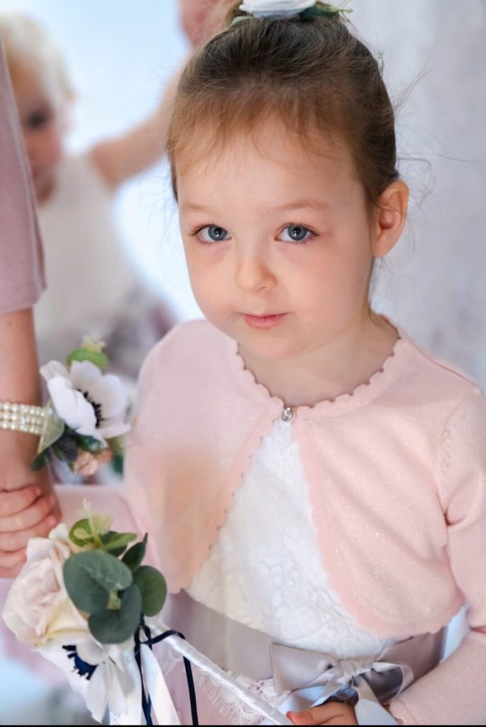 paper flower in corsage and flower girl wand