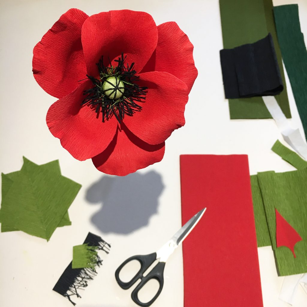 paper poppy by petal and bird