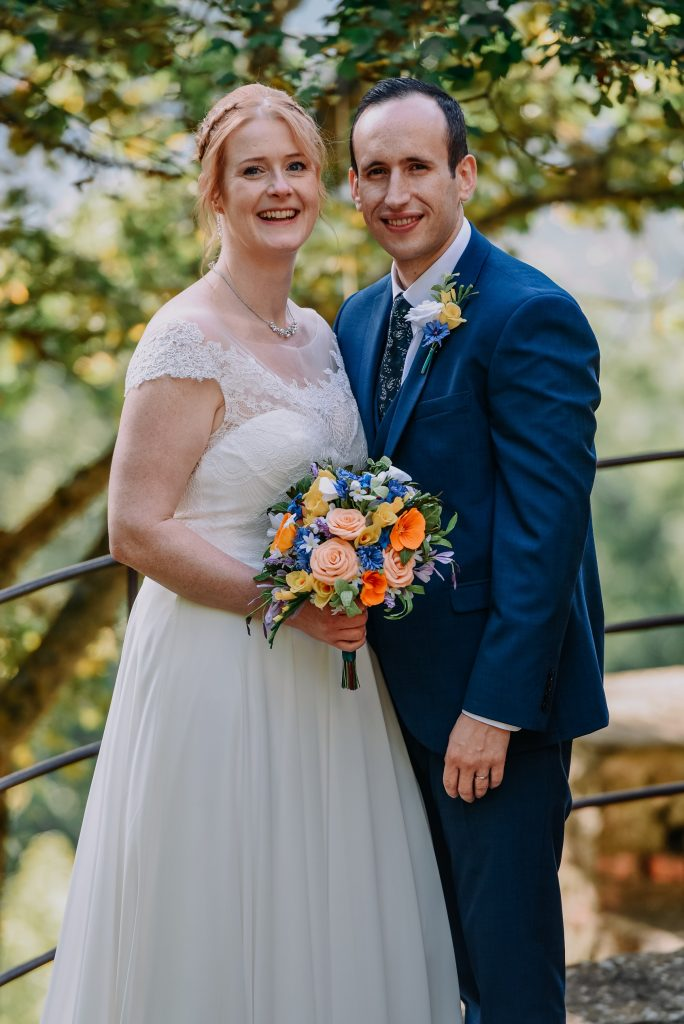 Bride and groom with paper wedding flowers