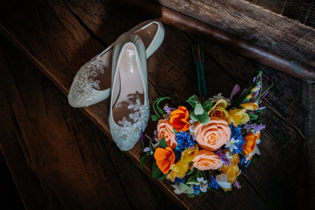 paper wedding bouquet and brides shoes